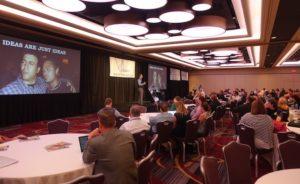 Brian Littleton giving a keynote speech.